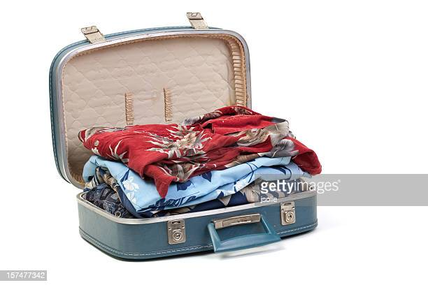 Blue suitcase full of clothes