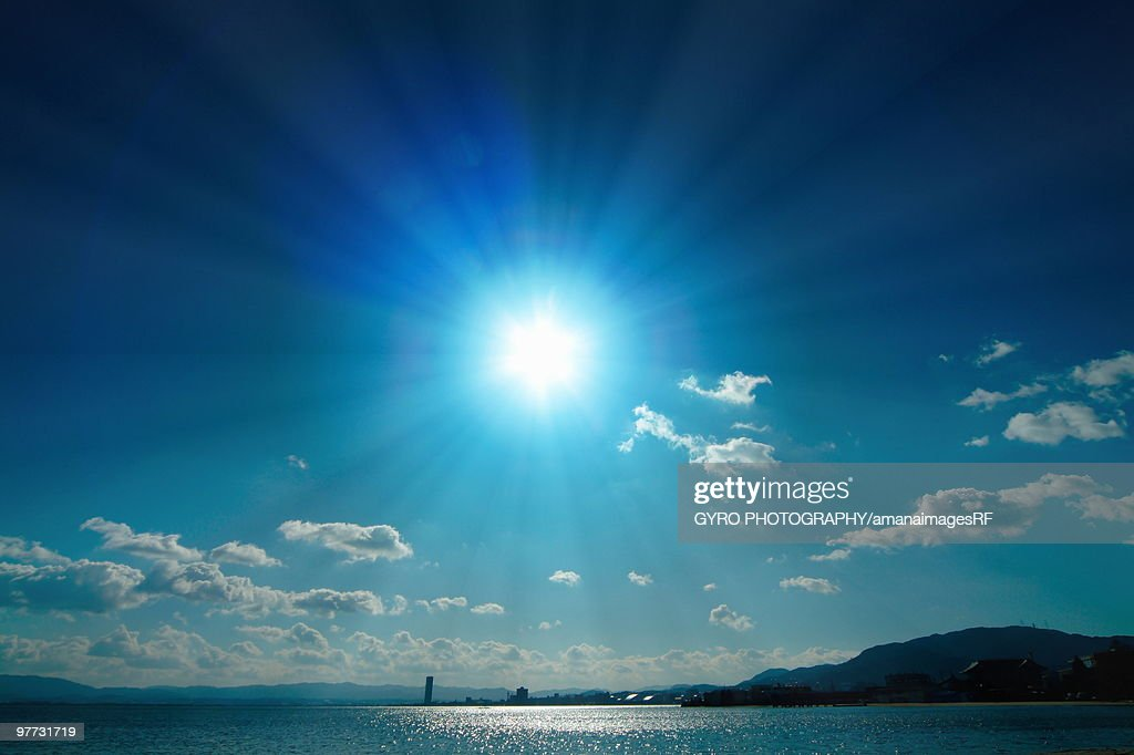 Blue sun over Biwa Lake. Otsu, Shiga Prefecture, Japan : Stock Photo