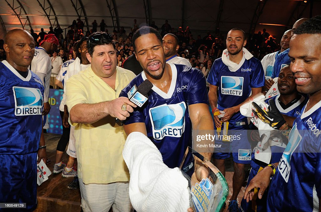 Blue team celebrates their victory at DIRECTV'S 7th annual celebrity Beach Bowl at DTV SuperFan Stadium at Mardi Gras World on February 2, 2013 in New Orleans, Louisiana.