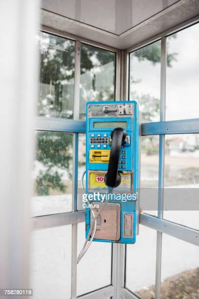 Blue telephone in telephone booth, Panama city, Panama