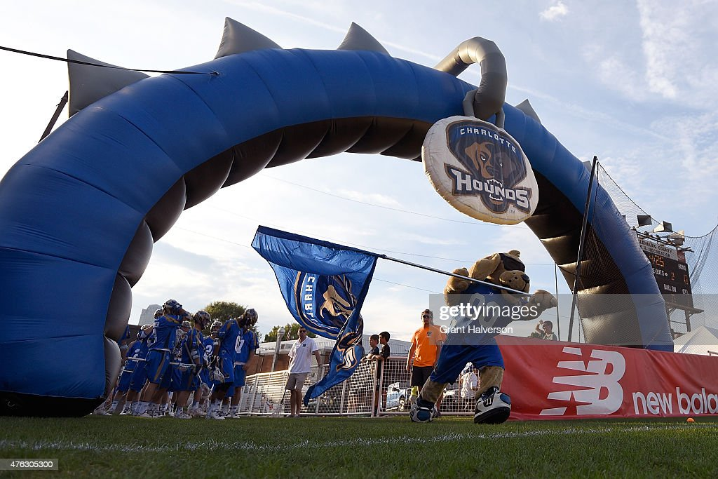 Blue the Charlotte Hounds mascot leads the team onto the field for a game against the Ohio Machine at American Legion Memorial Stadium on June 5 2015...