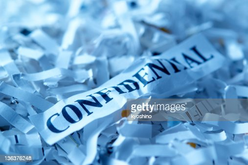 Blue tinted image of shredded confidential documents