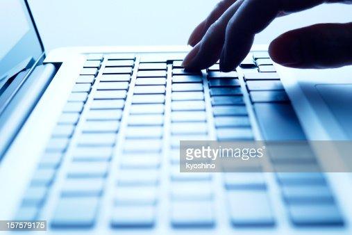 Blue tinted image of typing keyboard