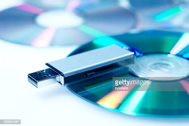 Blue tinted image of USB flash memory with CD