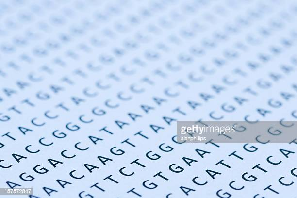 Blue tinted printout of DNA nucleotide sequence on paper