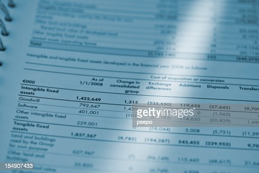 blue toned image of financial report