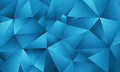 blue background image of triangle geometric shapes in a vector style but constructed of multiple layers of textured art paper to give a natural texture with actual photographic images