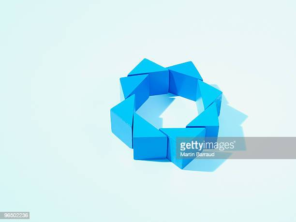 Blue triangles arranged in a circle