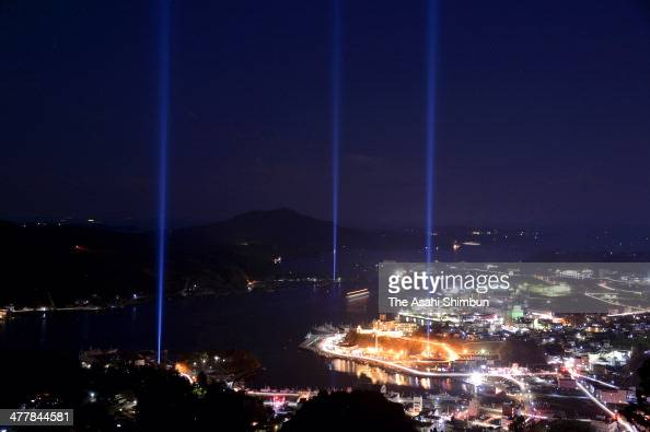 Blue tribute lights illuminate the sky to commemorate the victims of the magnitude 90 earthquake and subsequent tsunami three years ago on March 11...