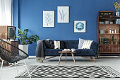 Blue up-to-date decor of lounge with blue sofa and patterned carpet