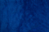 Blue velvet fabric background texture close up.