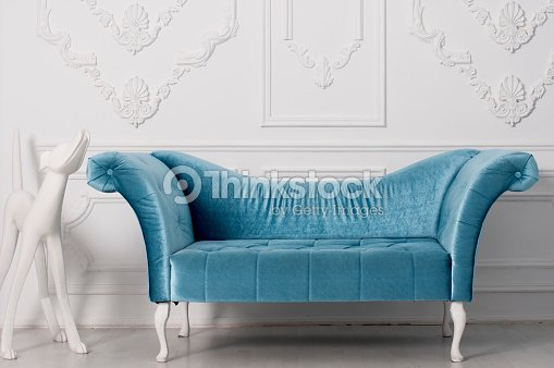 Blue Velvet Sofa And And White Sculpture Of A Dog Stock-Foto ...