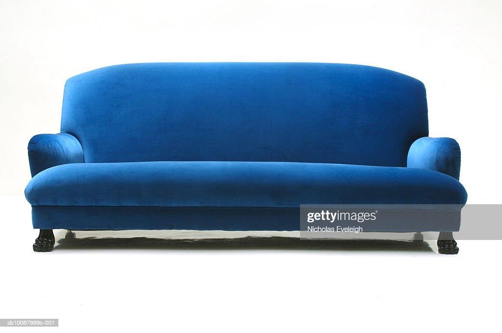 Blue velvet sofa on white background : Stock Photo