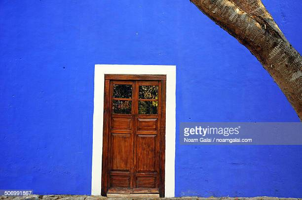 Blue wall and a wooden door
