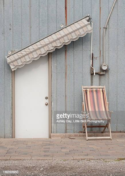 Blue wall with white door and chair