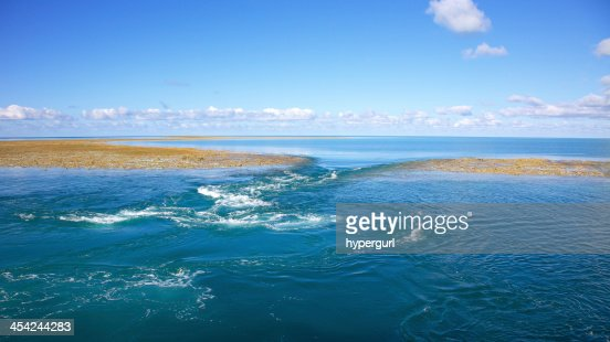 Blue water background with reef on low tide. : Stock Photo