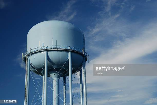 Blue water tower and cloudy sky