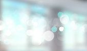 Blue window panoramic blurred bokeh lights bakground.Grey cyan light wallpaper.