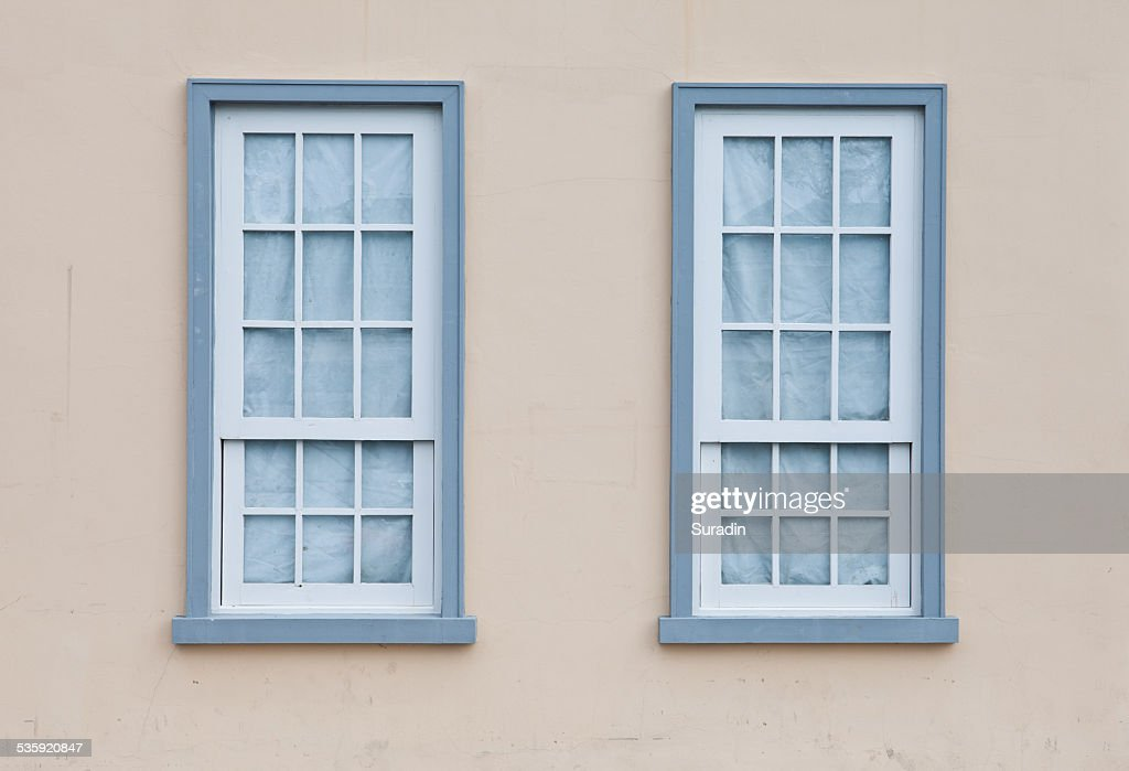 Blue windows on a wall : Stock Photo