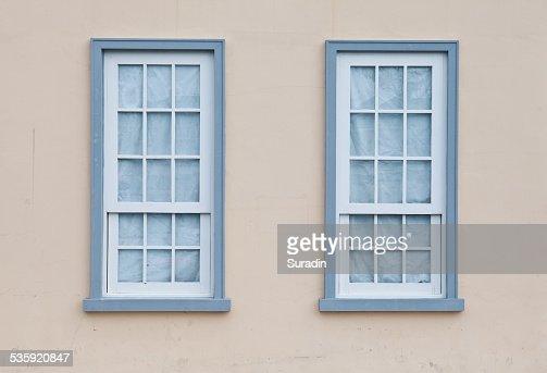 Blue windows on a wall : Stock Photo