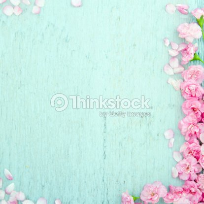 Blue Wooden Background With Pink Flowers Stock Photo Thinkstock