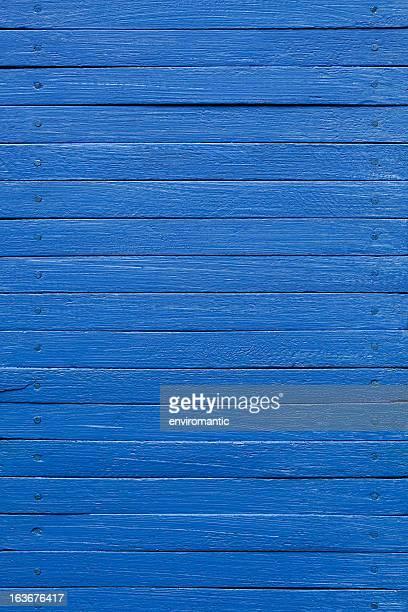Blue wooden board background.