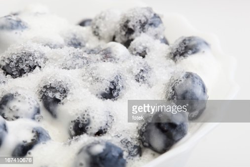 Blueberries whipped cream and sugar : Stock Photo