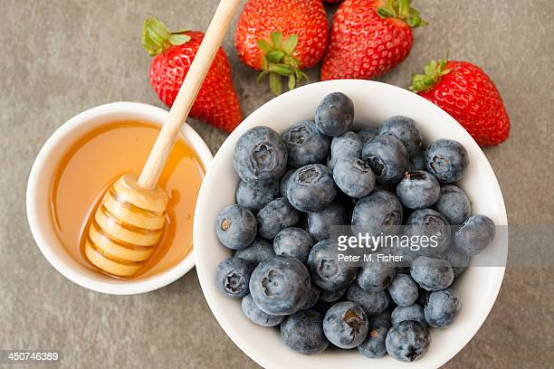 Blueberries with strawberries and honey