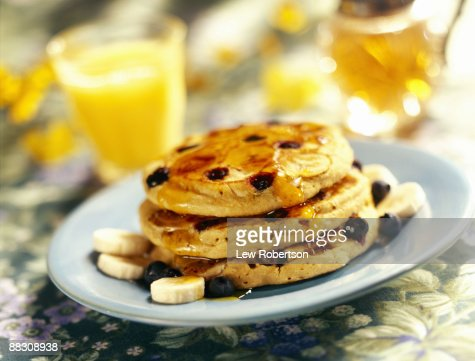 Blueberry banana pancakes with syrup : Stock Photo