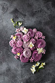 delicious blueberry meringues on dark grey  background, top view