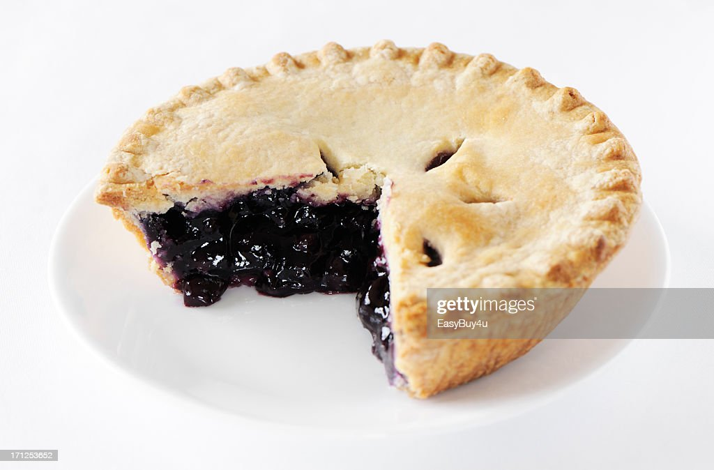Blueberry pie with missing slice