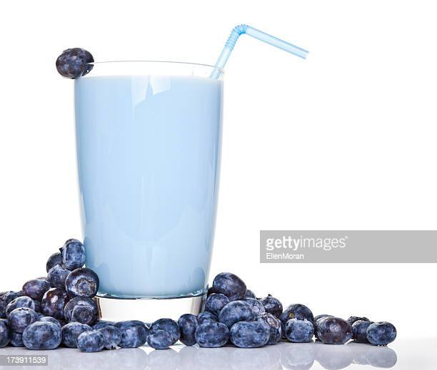 Blueberry smoothie surrounded by blueberries