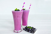 Blueberry smoothies and blueberry yogurt fruit for slimming on a white wooden background.