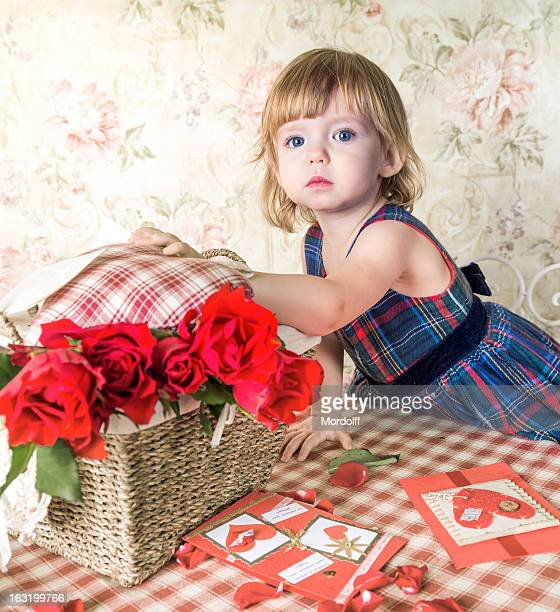 Blue-eyed baby and basket with roses