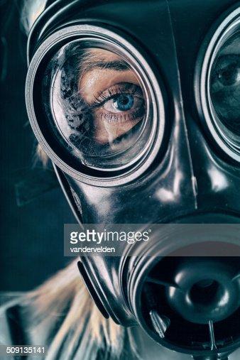 Blue-eyed Girl Wearing A Gas Mask