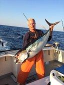Fisherman posing with large bluefin tuna