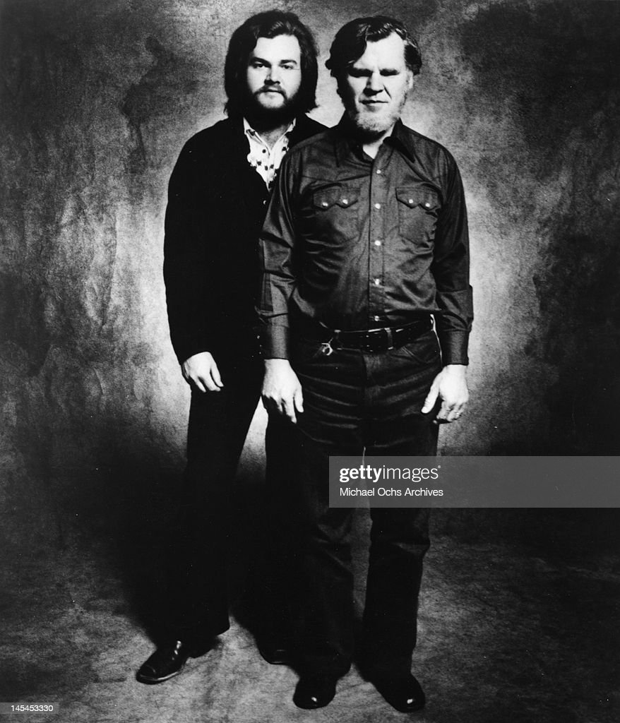 Bluegrass musicians Doc Watson and his son Merle Watson pose for a portrait in circa 1975.
