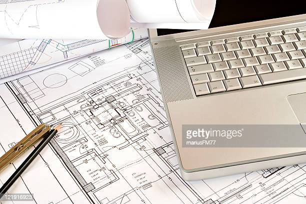 blueprint and laptop