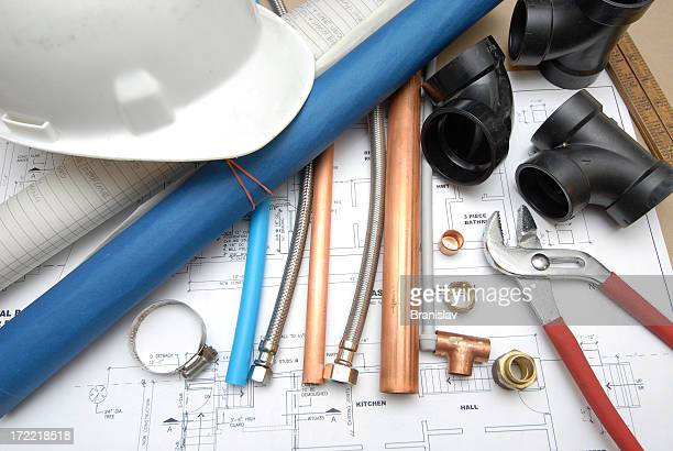A blueprint and plumbers tools