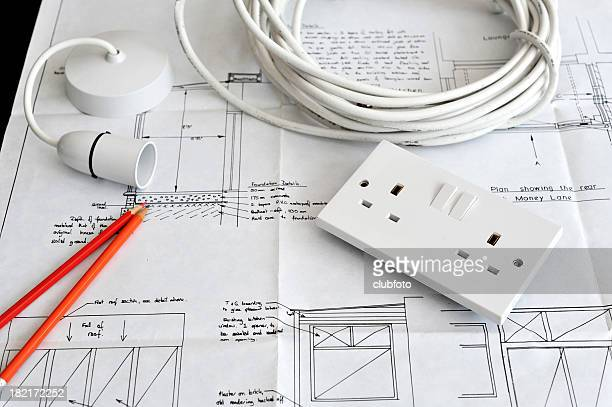 Blueprint plans of home building and construction with electrical items.