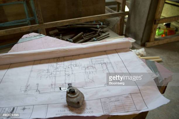 Blueprints sit at the Donohoe Construction Co Bentley retail and apartment building under construction in Washington DC US on Wednesday May 14 2014...
