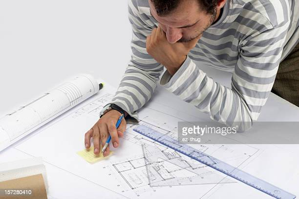 Blueprints with man drawing designs
