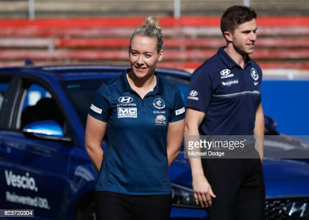 Blues AFL Captain Marc Murphy and Blues AFLW Captain Lauren Arnell pose with a Hyundai car after the club signed a new five year sponsor agreement...