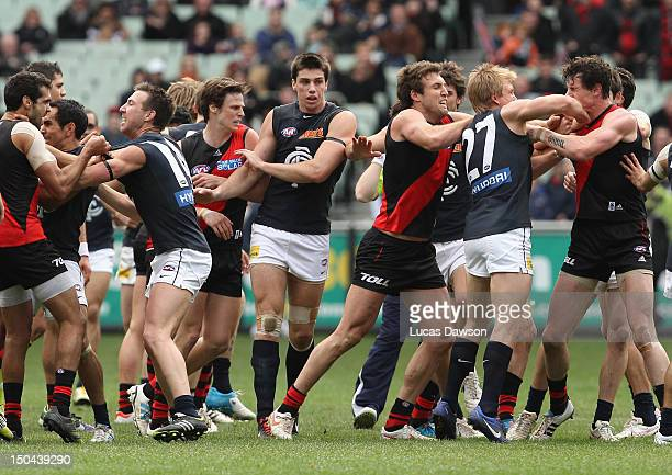 Blues and Bombers players wrestle during the quarter time break during the round 21 AFL match between the Essendon Bombers and the Carlton Blues at...