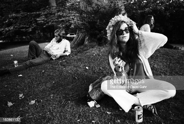 Blues and rock singer songwriter Janis Joplin poses for a portrait backstage at the Newport Folk Festival in July 1968 in Newport Rhode Island