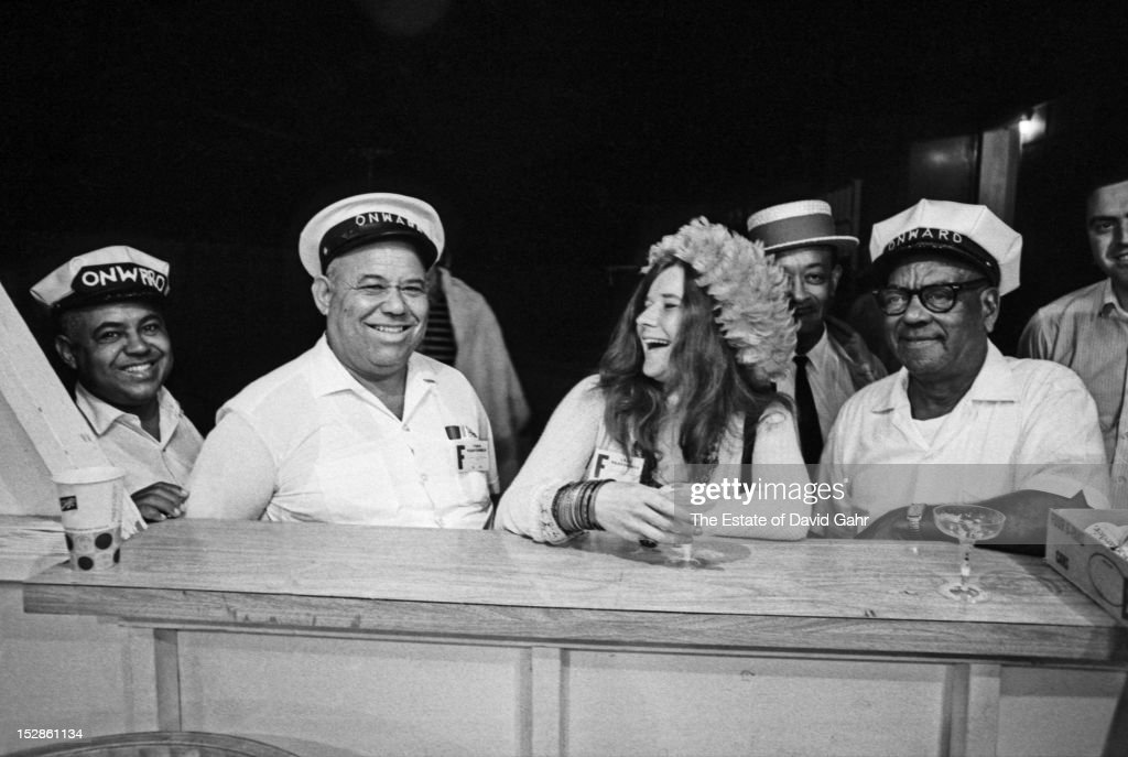 Blues and rock singer songwriter Janis Joplin (center) poses for a portrait with members of the Onward Brass Band, a New Orleans-based brass ensemble, in July, 1968 at the Newport Folk Festival in Newport, Rhode Island.
