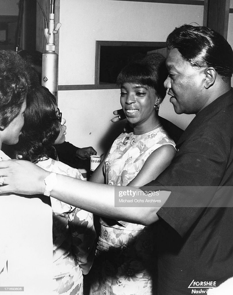 Blues and soul singer Bobby 'Blue' Bland in the recording studio with backup singers inlcuding perhaps Shirley Ellis circa 1960 in Nashville Tennessee