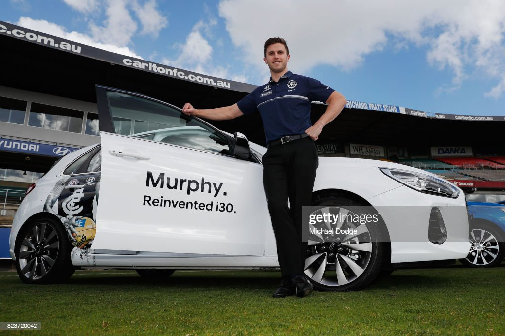 Blues Captain Marc Murphy poses with a Hyundai car after the club signed a new five year sponsor agreement with the car maker during a Carlton Blues AFL training session at Visy Park on July 28, 2017 in Melbourne, Australia.