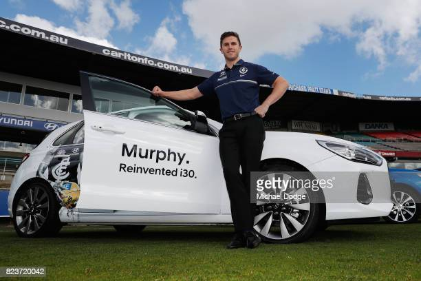 Blues Captain Marc Murphy poses with a Hyundai car after the club signed a new five year sponsor agreement with the car maker during a Carlton Blues...