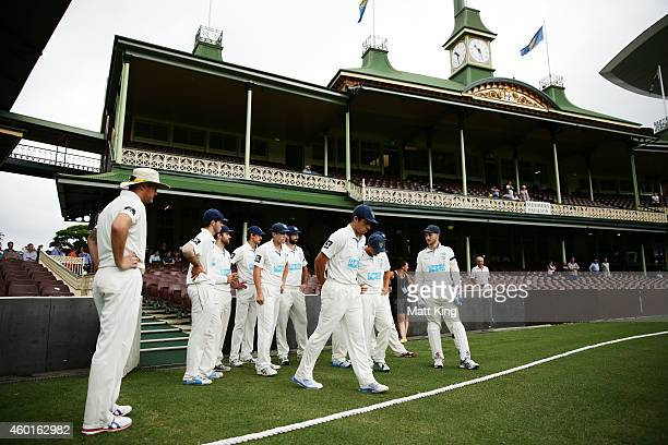 Blues captain Moises Henriques leads his side onto the field after blues players observed a moments silence for the late Phil Hughes during day one...